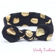 Černá dětská vázaná čelenka se zlatými puntíky