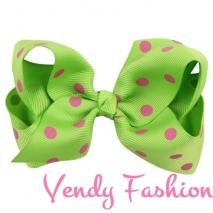 Zelená mašle do vlasů s růžovými puntíky