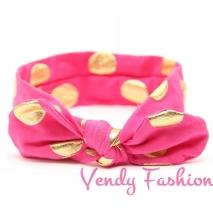 Tmavě růžová dětská vázaná čelenka se zlatými puntíky