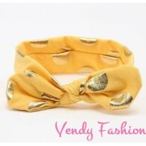 Žlutá dětská vázaná čelenka se zlatými puntíky